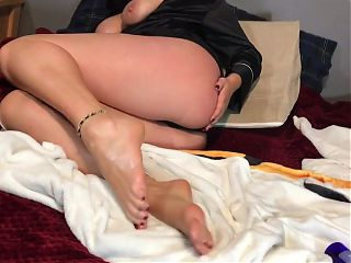Sexy big tit amateur spreads oil on her feet.